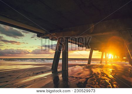 Glenelg Beach At Sunset Viewed From Under The Jetty, South Australia
