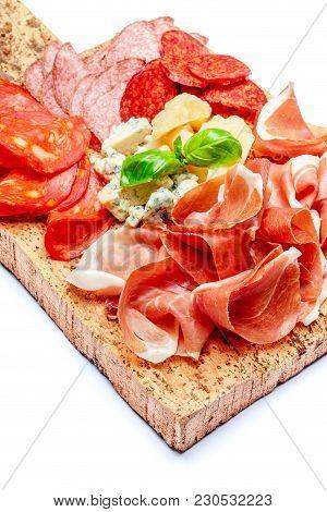 Italian Prosciutto Crudo Or Spanish Jamonand Cheese. Raw Ham On Cork Cutting Board. White Background