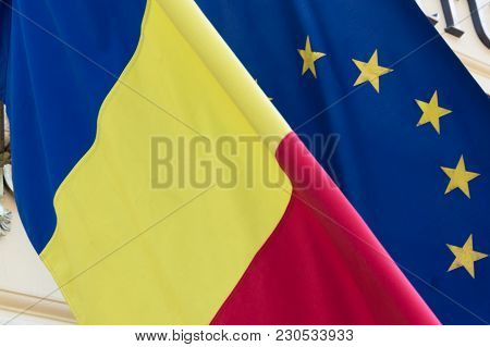 Flag Of The European Union Covered With The Romanian Flag. Political Relations And Union Concept. Cl
