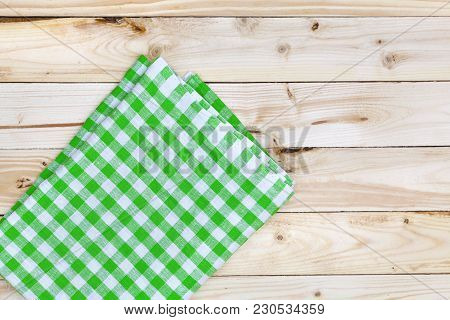 Green Checkered Tablecloth On A Light Wooden Table, Top View