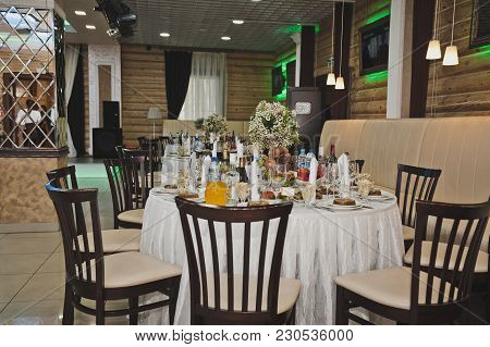 A Round Table With Snacks And Salads At The Holiday Table.