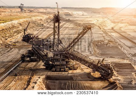 Bucket-wheel Excavator Mining In A Brown Coal Open Pit Mine.