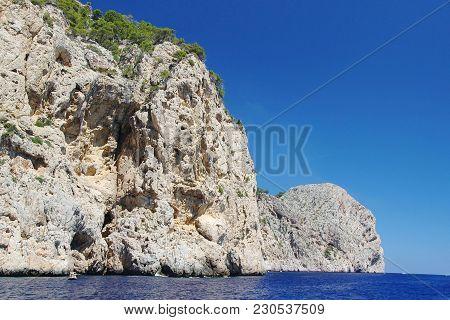 Amazing Stone Landscape And Blue Water Of Mediterranean Sea. Beautiful Background. Spain. Palma De M