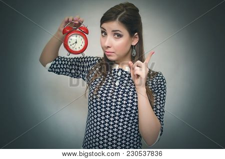 Strict Boss Woman Holding In Hands Red Alarm Clock And Showing An Index Finger. Job Or School Late W