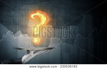 Hand Of Waitress Presenting Flaming Question Mark