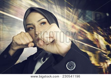 Creative Ideas Concept, Successful And Aggressive Young Muslimah Businesswomen Over Abstract Double