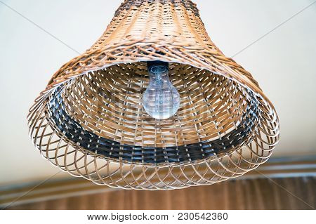 Bulb In A Wicker Lampshade In A Natural Background