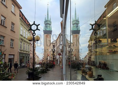Znojmo/ Czech Republic - December 28, 2017. Town Hall Tower Is Reflected In A Shop Window During Chr