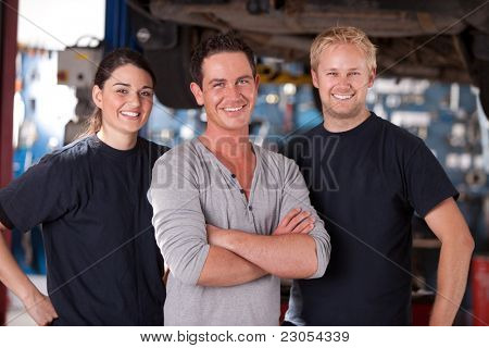 Portrait of a group of mechanics standing in a shop