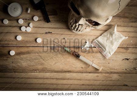 Drugs, Powder, Syringe And Tablets On Rustic Wooden Background. Drug Addiction Concept Background Wi