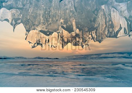 Ice Cave Close Up In Baikal Water Lake With Sunset Sky Background, Siberia Russia Natural Landscape