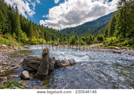 Boulders On Cascade Of The Forest River. Beautiful Landscape In Mountains On A Bright Day. Lovely Ti