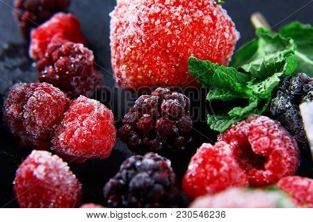 Macro Frozen Raspberry, Blac Kberry, Strawberries Mint Leaves, Pieces Of Ice On A Black Shale Board,