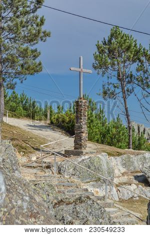 Christian Sculpture , Wood Cross And Stone In The Base , Placed On Top At The Portuguese Mountain