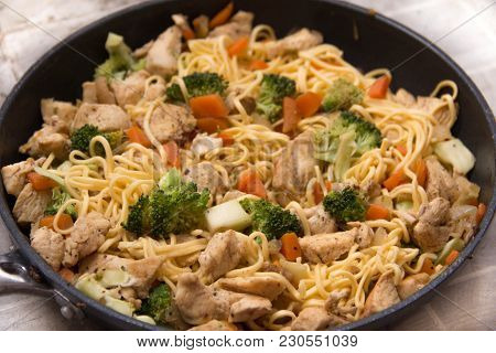 Asian Fried Egg Noodles With Chicken And Vegetables In The Pan Just Cooked. Fresh And Tasty Asian St