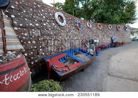 ICICI, CROATIA - MAY 25: Old fishing equipment, exposed as decoration in front of the restaurant in Icici, Croatia, on May 25, 2017.