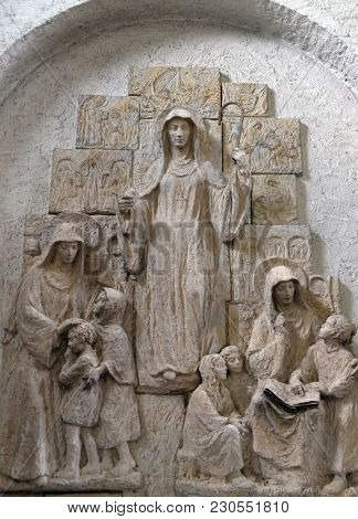 MUNSTERSCHWARZACH, GERMANY - JULY 09, 2017: saints Lioba of Tauberbischofsheim, Walburga of Heidenheim and Thekla of Kitzingen, altar in Munsterschwarzach Abbey, Benedictine monastery, Germany.