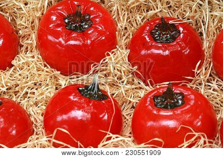 Fake Tomatoes Displayed At A Produce Stand Outside.