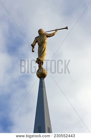 Sculpture Of Angel Moroni Atop Of A Mormon Temple.