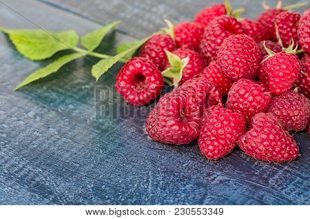 Raspberries On Rustic Wooden Board. Wooden Background With Raspberry, Copy-space