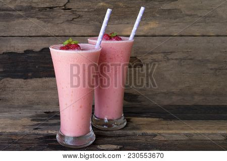Raspberry Smoothies Juice And Raspberry Fruits On Old Wooden Floor, Drink In The Morning To Good Hea