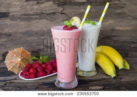 Raspberries Bananas Smoothies Juice And Raspberries, Fruit, Healthy Drink On A Wood Background.