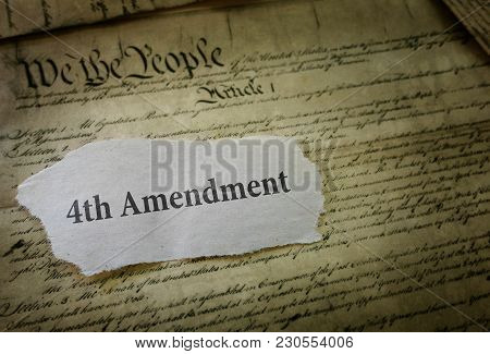 4th Amendment Newspaper Headline On A Copy Of The Us Constitution