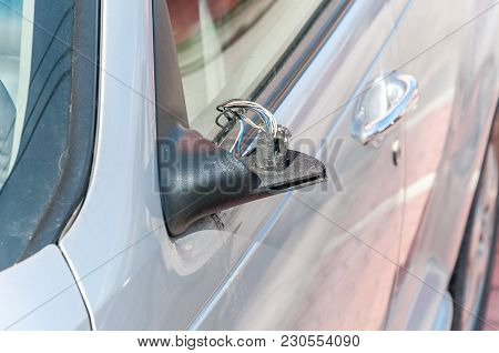 Broken And Damaged Side Mirror On The Car Doors With Remaining Wires