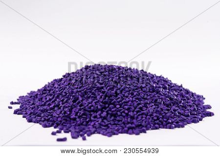 Violet Plastic Polymer Granules On White Background