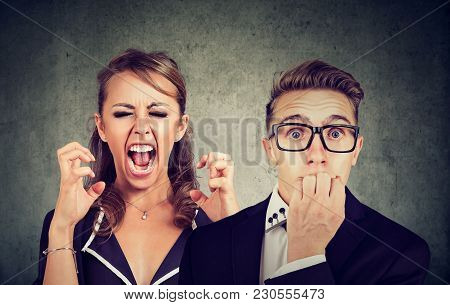 Angry Mad Woman Screaming And Fearful Stressed Man