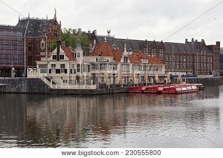 Amsterdam, Netherlands - June 25, 2017: Tourist Information Office And Cafe-restaurant Loetje Near A