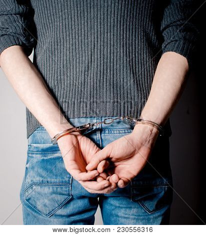 Handcuffs On Hand. Law Violation. Arrested Man.