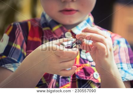Steel Spinner Cute Young Boy Playing With Fidget Spinner