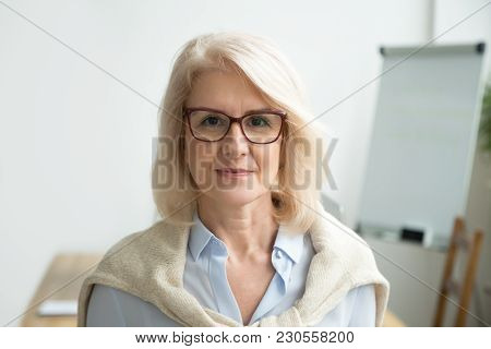 Confident Aged Businesswoman Wearing Glasses Looking At Camera, Skilled Experienced Senior Female Pr