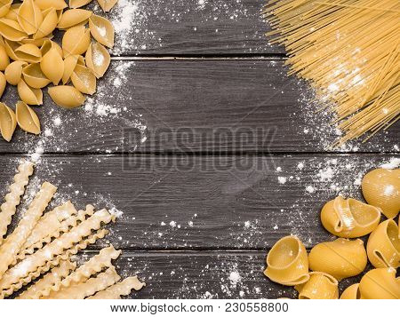Appetizing Assorted Pasta On Vintage Wooden Background