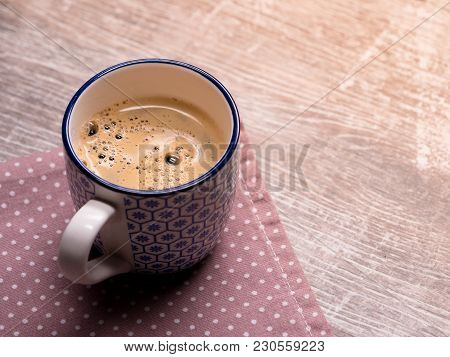 A Cup Of Freshly Prepared Coffee On The Table
