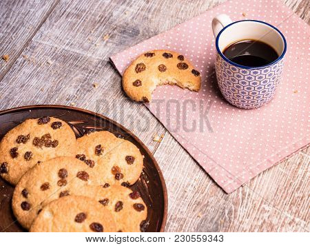 Homemade Cookies With A Cup Of Coffee On The Table