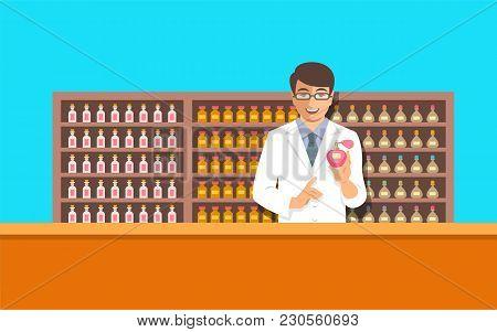 Perfumer Near A Perfume Organ. Young Man Holding Spray With New Custom Made Aroma Composition Near S
