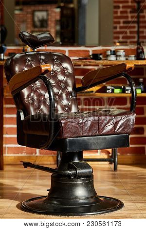 Barber Shop, Hairdresser Chairs Made From Brown Leather. Retro Leather Chair Barber Shop In Vintage