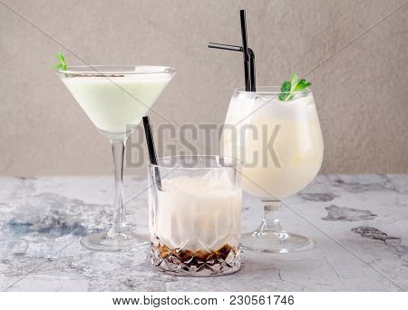 Group Of Cocktails On A Restaurant Background: Pina Colada, Coffee Cocktail Black Russian, Liquor In