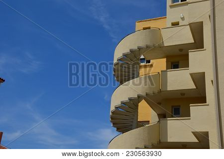 Zoom On A Spiral Staircase In The Blue Sky