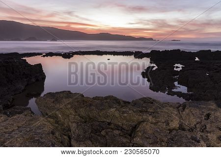 Nice Long Exposure Image In The Sea At Sunset, Has Warm General Tones In Pinks And Oranges, The Fore