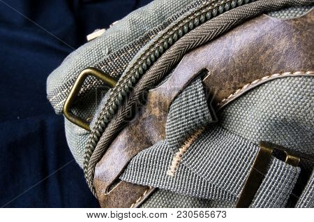 Closeup Of Buckles, Clasps, Zippers, Pockets, Fasteners, Fittings And Seams On The Hand Bag Of Coars