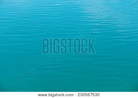 Crystal Clear Sea Water Texture. Natural Blue Background. Turquoise Ripple Water Reflection In Tropi