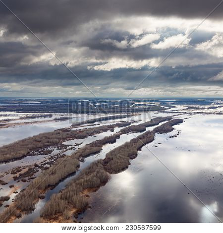 Aerial View Flooded Forest Plains In Spring Season.