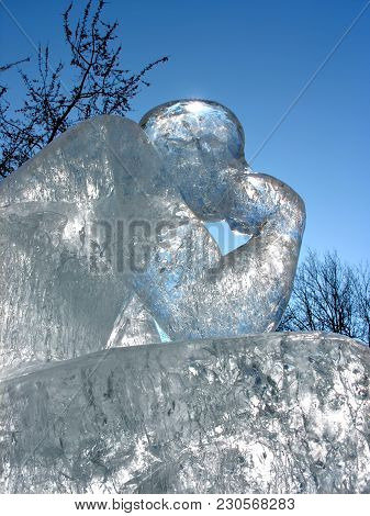 Icy Sculpture Of Sitting Human, Low Angle View