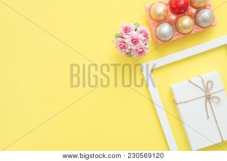 Flat Lay Top View Colorful Easter Egg Painted In Pastel Colors Composition And Spring Flowers On Yel