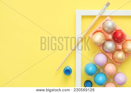 Flat Lay Top View Colorful Easter Egg Painted In Pastel Colors Composition With Paint Brush On Yello