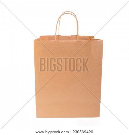 Paper bag with handles on white.
