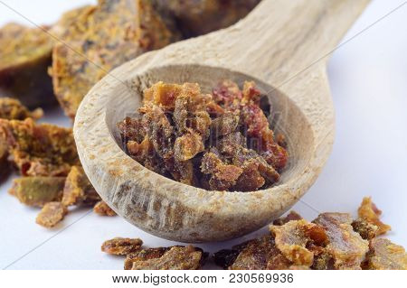 Propolis Granules In A Wooden Spoon. Bee Glue. Bee Products. Apitherapy. Apiculture